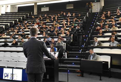 A filled lecture hall during a lecture